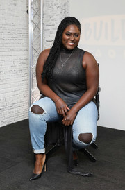 Danielle Brooks teamed her top with a pair of torn jeans.