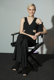 Coco Rocha looked fashion-forward in a black jumpsuit with waist cutouts and wide legs during her BUILD interview.