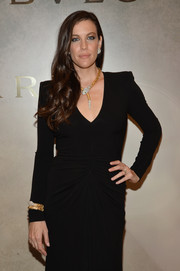 Liv Tyler was pure elegance at the Bvlgari & Rome: Eternal Inspiration opening wearing a Serpenti gold and diamond bracelet and a matching necklace from the Italian jewelry brand.