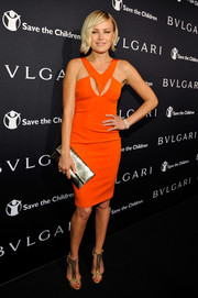 Malin Akerman brought a pop of color to the BVLGARI And Save The Children Pre-Oscar Event in a great orange dress with cutout details.
