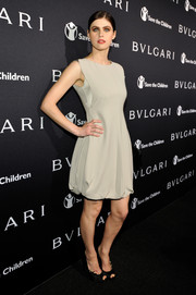 Alexandra Daddario looked cute at the BVLGARI And Save The Children Pre-Oscar Event in a nude dress.
