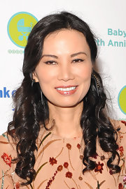 Wendi Deng had her locks curled and half tied up for the Baby Buggy anniversary party.