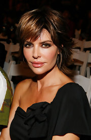 At the Baby Phat & KLS Collection fashion show, Lisa Rinna accented her bronzed skin and smoky eyes with a shimmery peach lipstick a hint of shine.