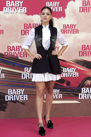 Eiza Gonzalez was all about preppy cuteness in an embellished black vest layered over a ruffled LWD at the 'Baby Driver' photocall in Madrid.