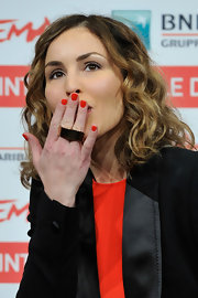 Noomi Rapace added a dose of sexiness to her menswear-inspired look with some bright red nail polish when she attended the 'Babycall' photocall.