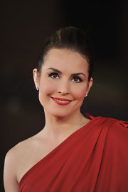 Noomi Rapace matched her dress with a lip color in the same rich hue when she attended the 'Babycall' premiere.