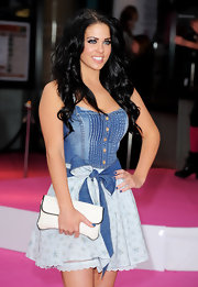 The British model showed off her raven-colored locks in a center-parted, voluminous, curled hairstyle.