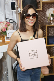 Constance Wu visited the Backstage Creations Giving Suite at the Emmys wearing a pair of round sunglasses.