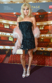 Pixie Lott got all frilled up in a dark-teal feather strapless dress by Fendi for the Backstage Gala.