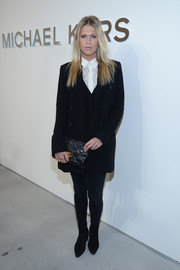 Alexandra Richards chose a quilted black clutch to complete her ensemble.