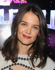Katie Holmes chose a bold red hue for her lips.