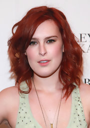 Rumer Willis ditched her brunette locks and opted for a fire engine red tresses. Soft side swept curls completed her new 'do.