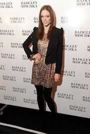 Coco Rocha shined at the Badgley Mischka show in this gold sequined dress.