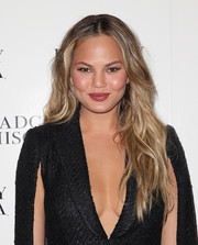 Chrissy Teigen attended the Badgley Mischka fashion show wearing her usual long wavy style.