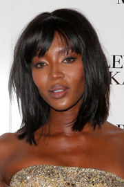 Naomi Campbell attended the Badgley Mischka fashion show wearing her hair in edgy-chic layers with wispy bangs.