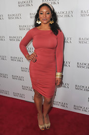 Tamala showed off her stunning curves at the Badgley Mischka store launch in a salmon body con dress.