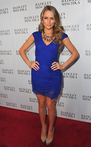 Shantel opted for a royal blue gathered cocktail dress for the Badgley Mischka store launch.