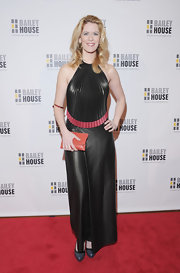 Alex McCord chose a black leather dress with a pleated bodice and halter neckline for her rock 'n' roll-inspired red carpet look.