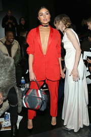 Olivia Culpo ravished in a red Baja East pantsuit worn sans shirt during the label's fashion show.