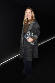 Alexandra Golovanoff kept warm in a gray tweed coat while attending the Balenciaga fashion show.
