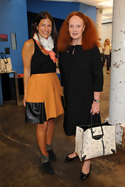 Grace Coddington attended Fashion's Night Out carrying a white Balenciaga cat print tote handbag.