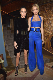 Kendall Jenner kept it fierce all the way down to her black lace-up cutout boots, also by Balmain.