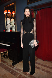 Ming Xi was trendy and sexy at the Balmain aftershow dinner in a black jumpsuit with sheer, dotted waist panels and sleeves.
