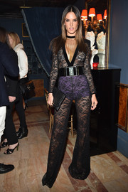 Alessandra Ambrosio worked the sheer trend yet again in a black Balmain lace jumpsuit during the label's aftershow dinner.