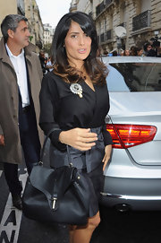 Salma Hayek looked extra chic with this slouchy black leather bag on her arm.