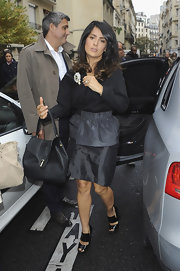 Salma Hayek kept her look sleek and chic with this thick-strapped pair of platform sandals.