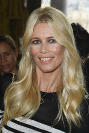 Claudia Schiffer looked like a doll with her lustrous waves at the Balmain fashion show.