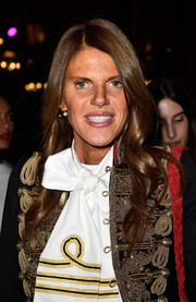 Anna dello Russo attended the Balmain fashion show wearing her hair in soft waves.