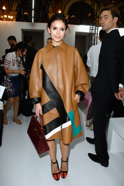 Miroslava Duma looked seriously chic in a Fendi leather coat when she attended the Balmain fashion show.
