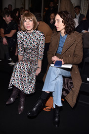 Anna Wintour attended the Balmain fashion show wearing an abstract-print midi dress.