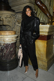 Cindy Bruna was rocker-chic in a shiny black jumpsuit at the Balmain Spring 2020 show.