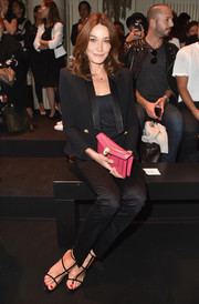 Carla Bruni-Sarkozy sat front row at the Balmain fashion show looking very polished in a black tuxedo.