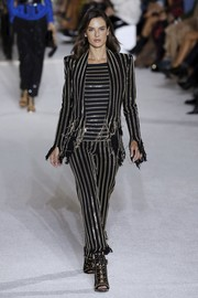 Alessandra Ambrosio rocked a chain-striped pantsuit on the Balmain runway.