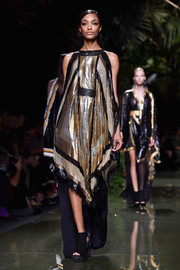 Jourdan Dunn looked quite the diva in a scarf-print chainmail dress while walking the Balmain runway.