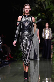 Stella Maxwell dazzled in a beaded cold-shoulder midi dress while walking the Balmain runway.