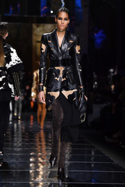 Cindy Bruna rocked a two-tone asymmetrical-hem leather coat on the Balmain runway.