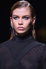 Stella Maxwell wore her hair straight and slicked down while walking the Balmain runway.
