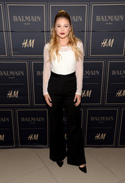 Olivia Holt kept it demure in a long-sleeve white lace top at the Balmain x H&M Los Angeles pre-launch.