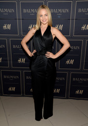 Mena Suvari opted for a black halter jumpsuit with a bowed belt when she attended the Balmain x H&M Los Angeles pre-launch.