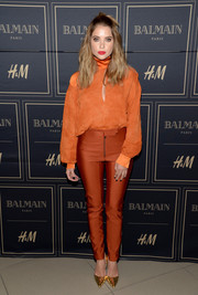 Ashley Benson brought a bright pop to the Balmain x H&M Los Angeles pre-launch with this orange turtleneck blouse by H&M.
