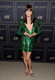 Selma Blair shimmered in a micro-beaded emerald mini dress by Balmain x H&M during the collection's pre-launch in Los Angeles.