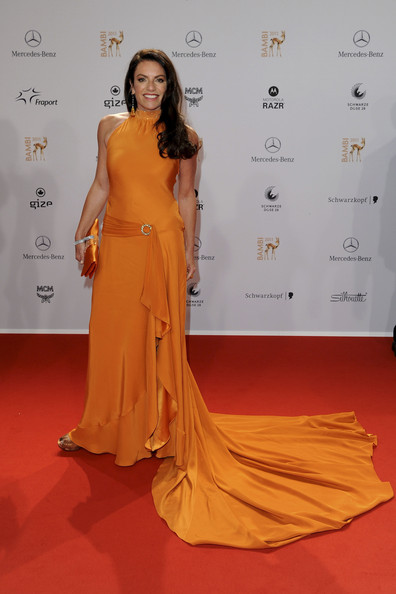 Christine Neubauer looked fabulous in this cascading orange evening gown. The silk ruffle looked effortless on her.