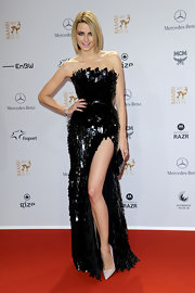 Eva Padberg brought out the sexy drama in a black textured strapless dress with a hip-high slit.