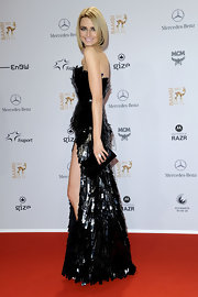 Eva Padberg accented her sequined frock with a demure black satin clutch.