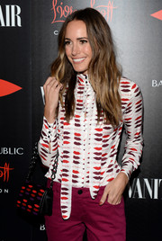 Louis Roe went matchy-matchy with this lip-print purse and blouse combo at the Banana Republic L'Wren Scott collection launch.
