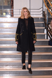 Olivia Palermo was fall-chic in a black military coat with gold trim during the Banana Republic x Olivia Palermo presentation.